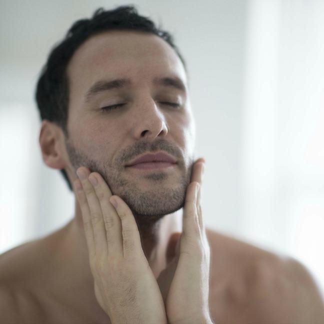Man putting on pro-collagen marine cream 30ml moisturiser for men
